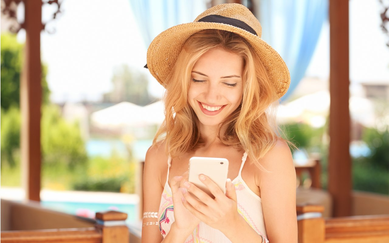 happy hotel guest with smart web app solution iQ App