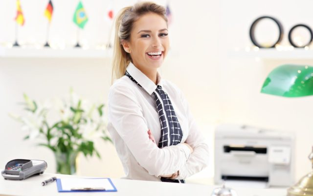 Happy receptionist working in hotel