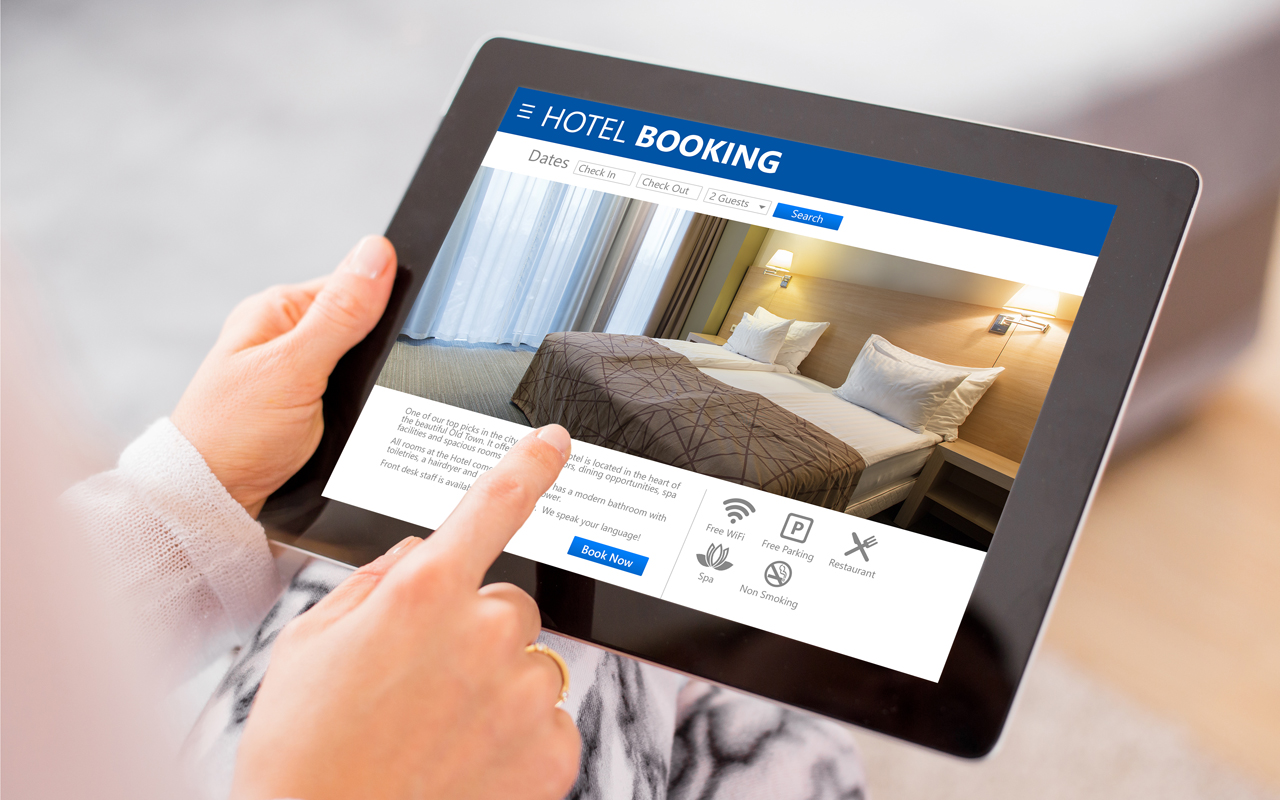 Guest books hotel room online with a tablet